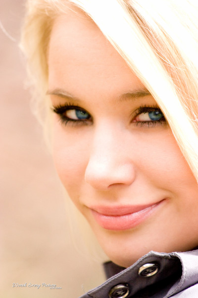 Gorgeous glamour close up shot of young blonde woman with the most stunning blue eyes